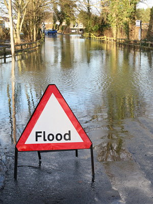 stock-photo-road-closed-because-of-flooding-122886424