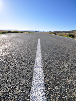 stock-photo-road-in-the-country-in-new-zealand-70722787