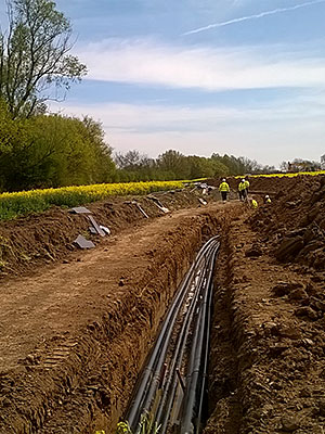 stock-photo-work-in-progress-burying-gas-pipe-in-a-country-area-124224460